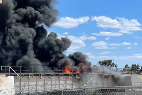 Smoke billows Saturday, June 5, 2021, from a fire on railroad tracks at a bridge in North Las V ...