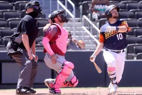 Aviators second baseman Nate Mondou dons pink socks as he watches a fly ball as the Sacramento ...