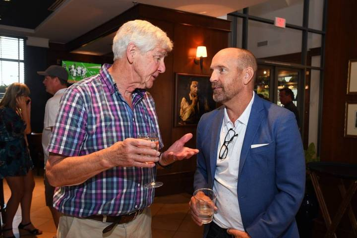 Roger Groves, left, and Simon Keith visit during the latter's foundation golf tournament at Rev ...