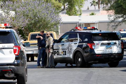 Police investigate a homicide Saturday morning, May 22, 2021, near the 3200 block of North Nell ...