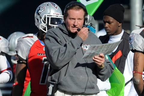 FILE - In this Nov. 27, 2010, file photo, then Las Vegas head coach Jim Fassel, center, looks o ...