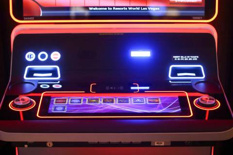 A slot machine with wireless phone charging capabilites is seen on the casino floor is seen dur ...