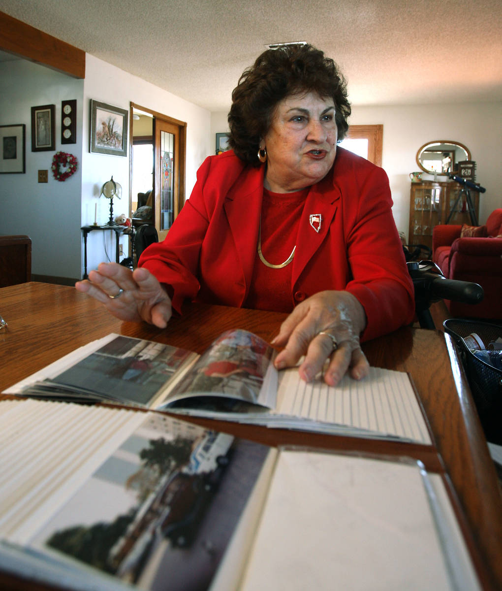 Liliam Lujan Hickey pages through photographs of Havana, Cuba, while talking in her home Tuesda ...