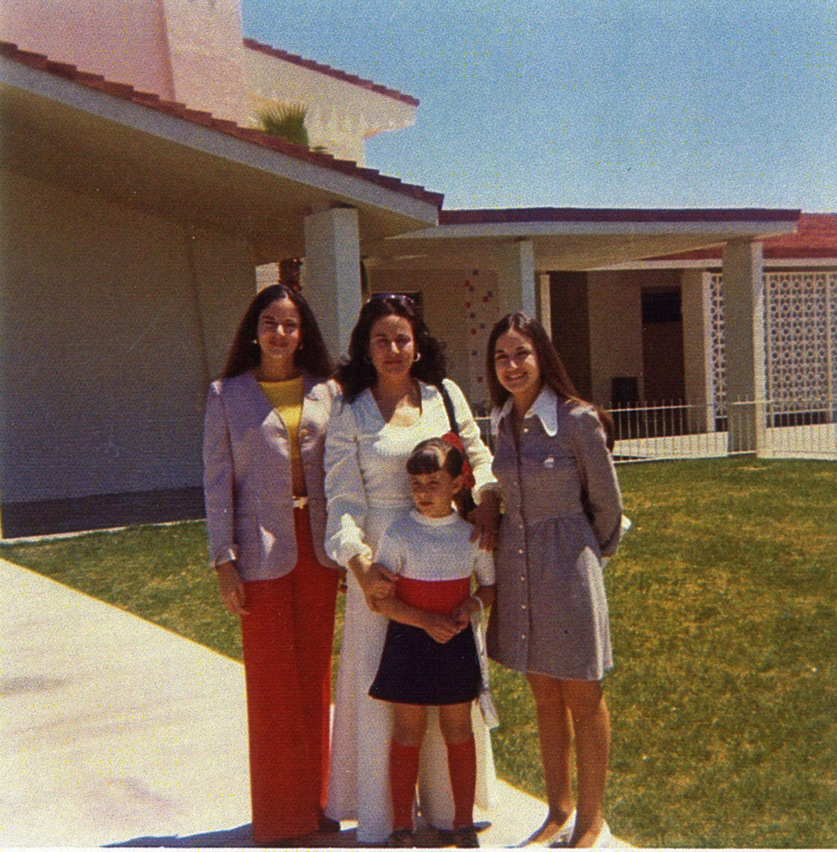 Lillam Lujan-Hickey (center) surrounded by her daughters, Lilliam Shell (left) Silvia Walsh (ri ...