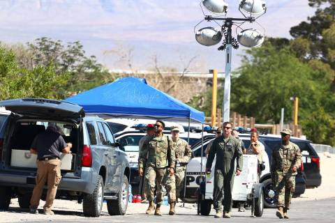 Military personnel investigate an airplane crash near Nellis Air Force Base, on Tuesday, May 25 ...