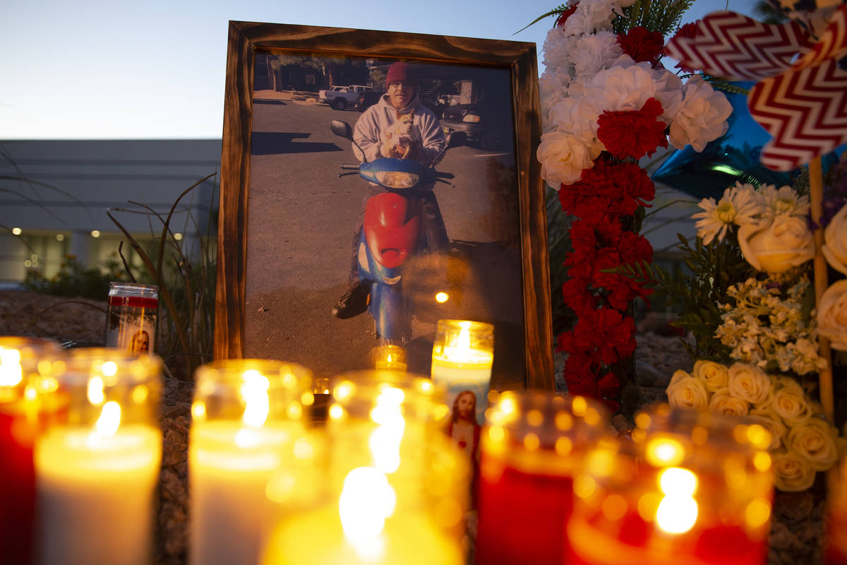 A photo of Walter Anderson on his moped during a vigil near the intersection where he was kille ...
