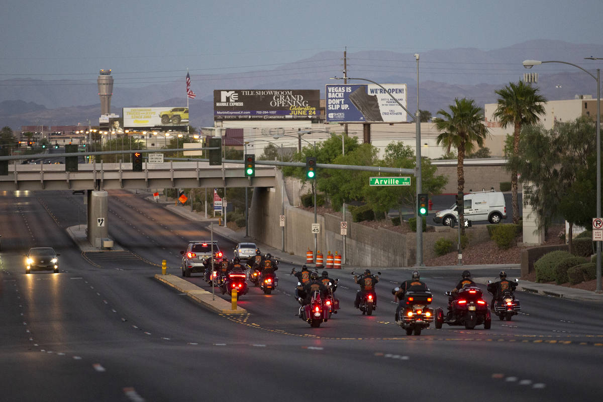 The Marine Riders Motorcycle Club drives away after attending a vigil for Walter Anderson near ...
