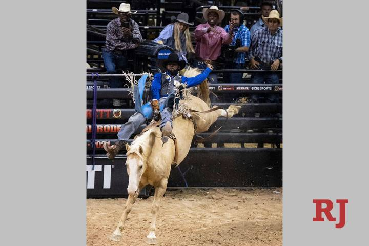 Tre Hosley, of Compton, Calif., rides Trigger while competing in bareback riding at the Bill Pi ...