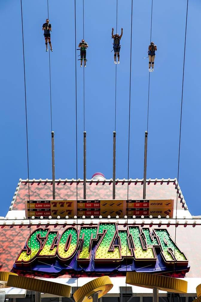 Slotzilla riders leave the platform for a run down the zipline at the Fremont Street Experience ...