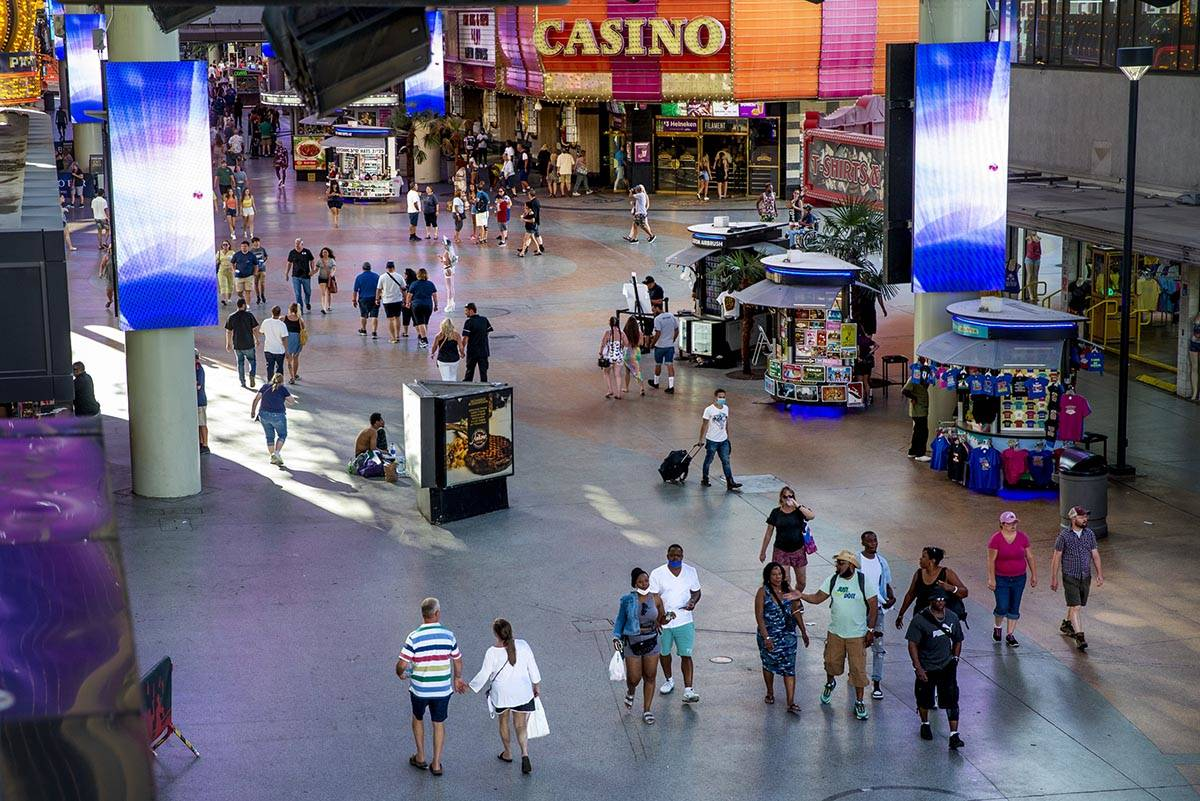 Visitors wander along the shops near the D Las Vegas at the Fremont Street Experience on Monday ...