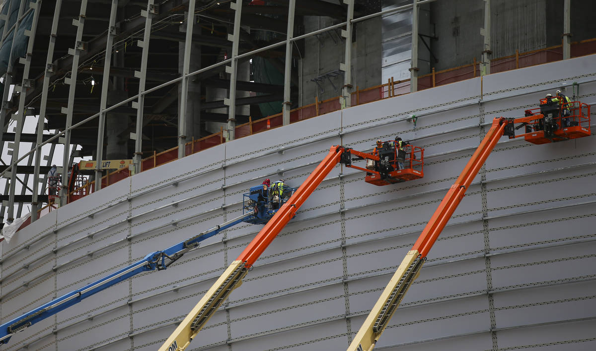 Construction workers on lifts make progress during a tour of the Madison Square Garden Sphere a ...