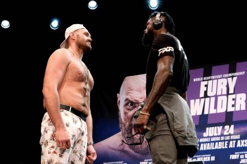 Tyson Fury, left and Deontay Wilder face off at a news conference in Los Angeles on Tuesday, Ju ...