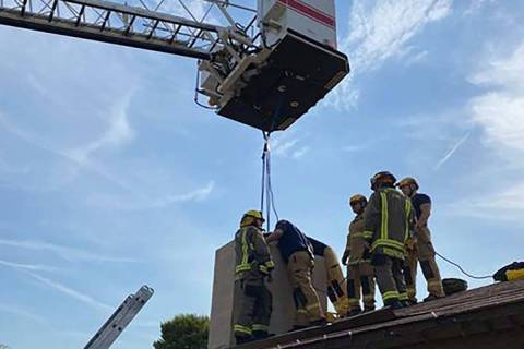 Henderson firefighters rescue an 18-year-old woman from the chimney of a home near Horizon Driv ...