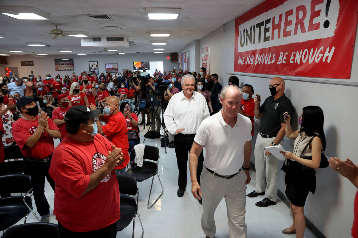 D. Taylor, president of the Culinary's parent union, UNITE HERE, right and Gov. Steve Sisolak a ...