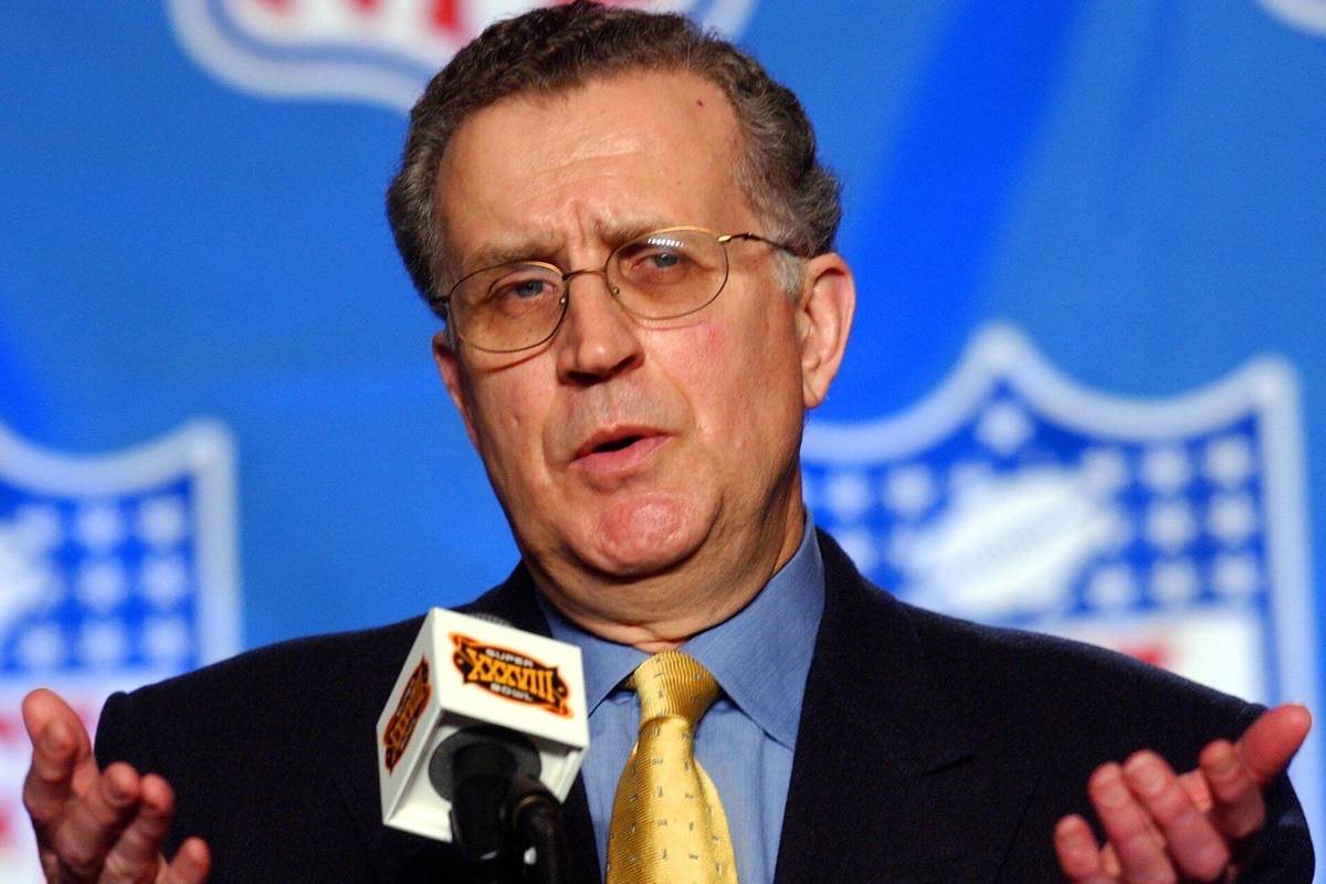 National Football League Commissioner Paul Tagliabue talks with reporters during a news confere ...