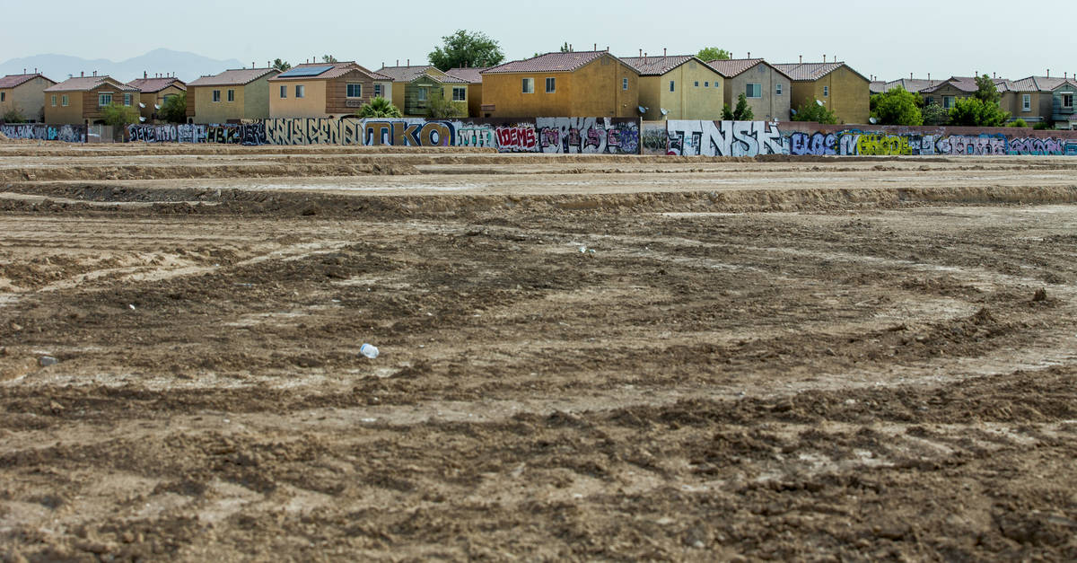A graffiti-covered wall on the east side of the property still remains as construction begins o ...