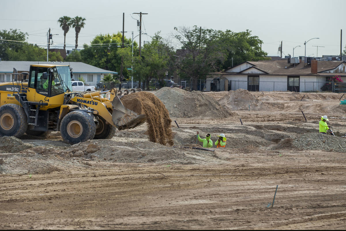 A construction crew begins work on Arcadia by Harmony Homes off of Rancho Drive on Wednesday, J ...