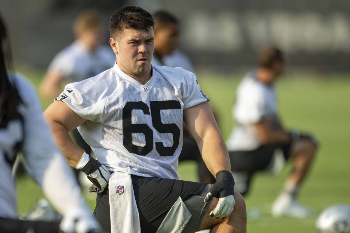 Raiders center Jimmy Morrissey (65) stretches during an NFL football practice on Wednesday, Jun ...