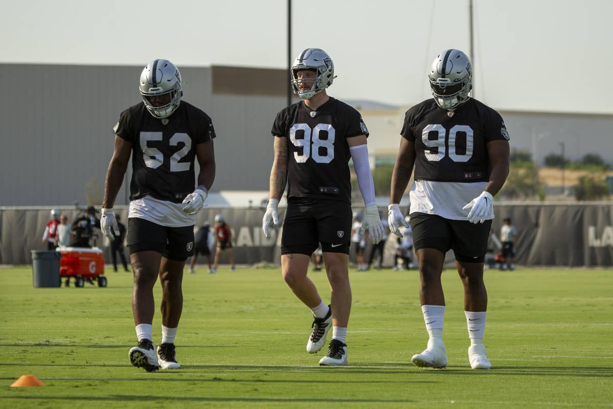 Raiders linebacker Gerri Green (52), defensive end Maxx Crosby (98) and defensive tackle Johnat ...