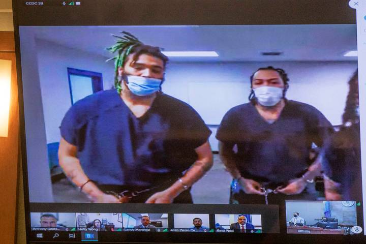 Dasean Williams, from left, and Marcus Parker, right, appear in court virtually for a hearing a ...
