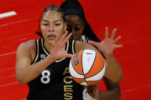 Las Vegas Aces center Liz Cambage (8) receives a ball against Los Angeles Sparks forward/center ...