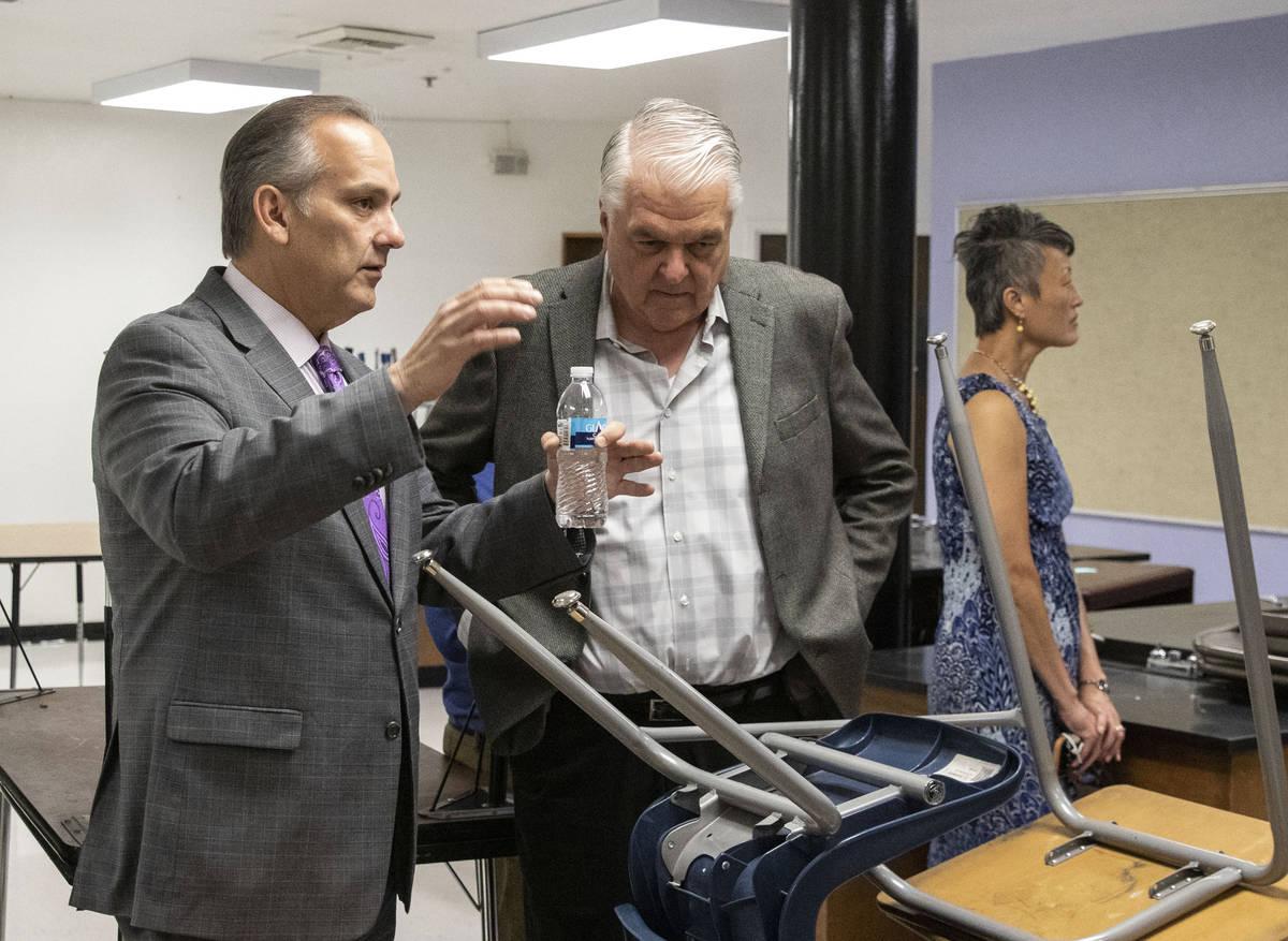 The Clark County School District Superintendent Jesus Jara, left, and Gov. Steve Sisolak discus ...