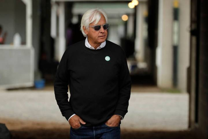 In this May 1, 2019, file photo, trainer Bob Baffert looks out from his barn before a workout a ...