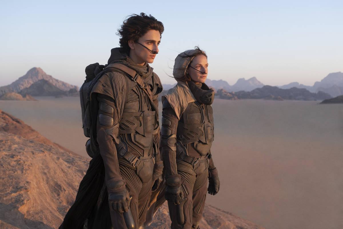 "TIMOTHÉE CHALAMET as Paul Atreides and REBECCA FERGUSON as Lady Jessica Atreides in ""Dune."" (C ..."