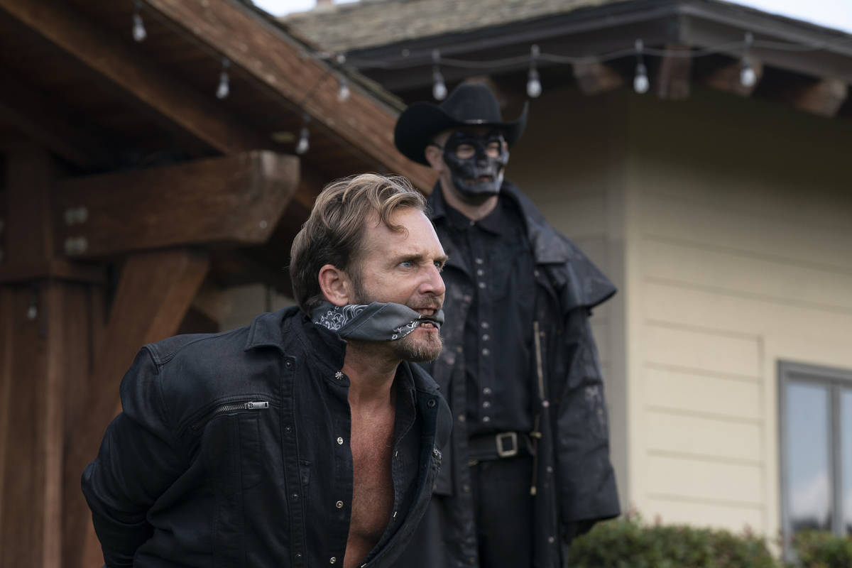 (from left) Dylan Tucker (Josh Lucas) and a Purger in The Forever Purge, directed by Everardo G ...