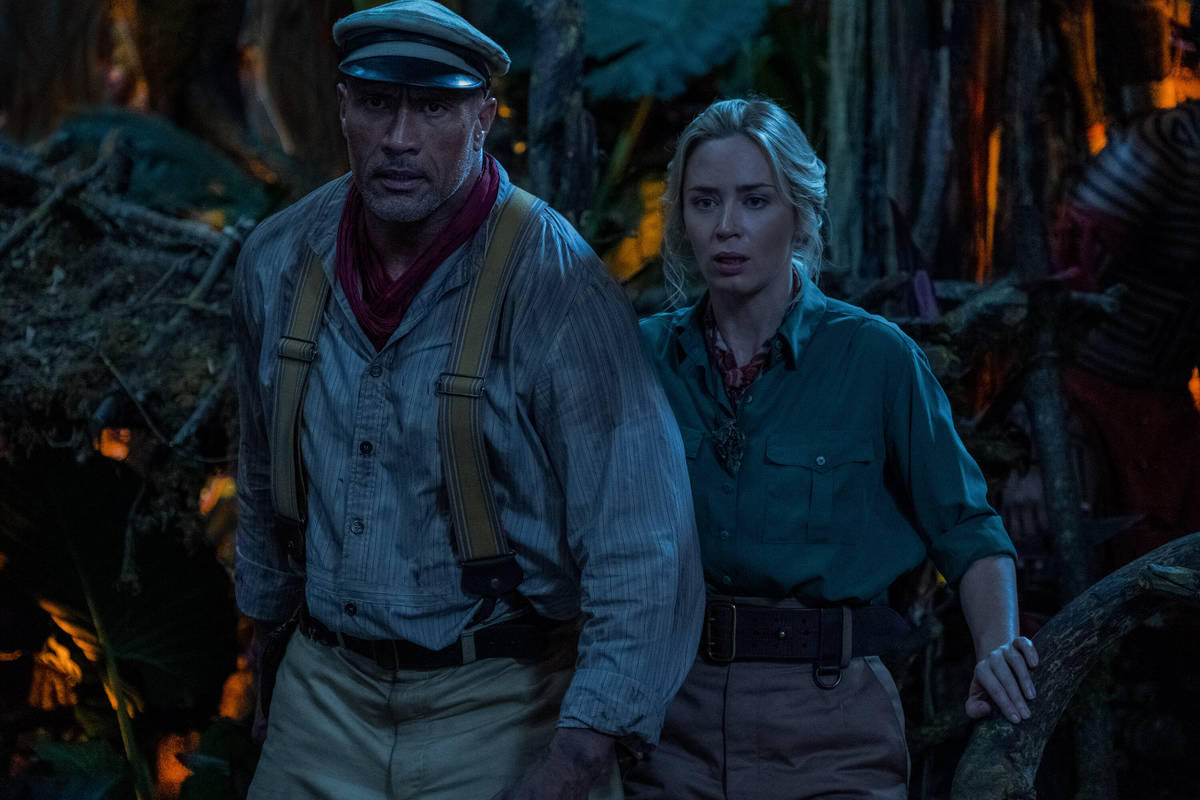Dwayne Johnson is Frank Wolff and Emily Blunt is Lily Houghton in Disney's JUNGLE CRUISE ...