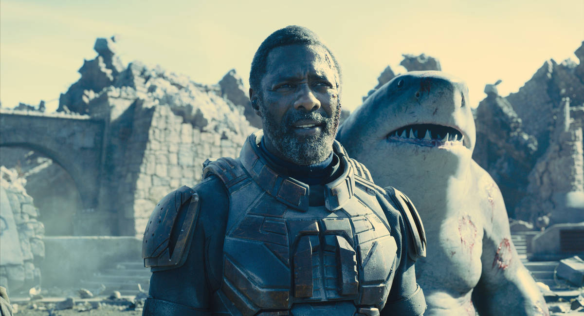 """IDRIS ELBA as Bloodsport and KING SHARK appear in a scene from """"THE SUICIDE SQUAD."""" (Warne ..."""