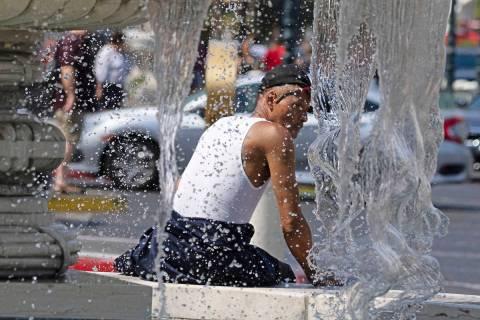 Darrick Washington takes a break next to The Venetian fountain, on Friday, June 18, 2021, in La ...