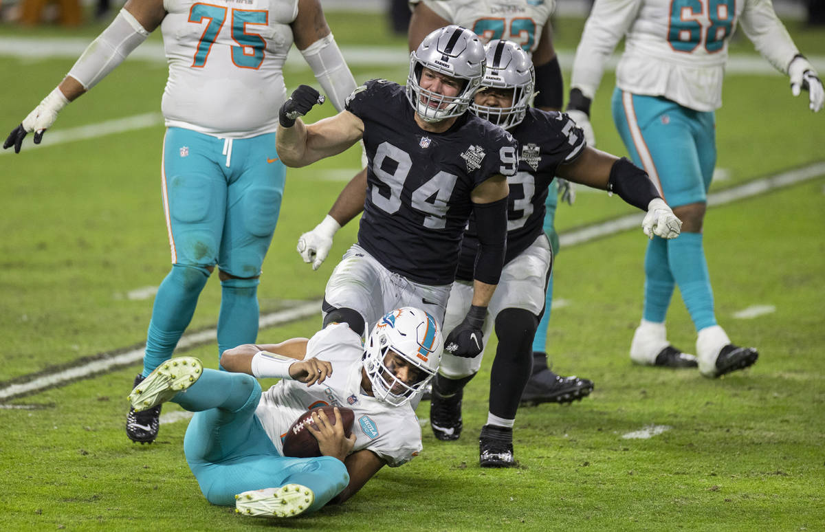 Raiders defensive end Carl Nassib (94) sacks Miami Dolphins quarterback Tua Tagovailoa (1) in t ...