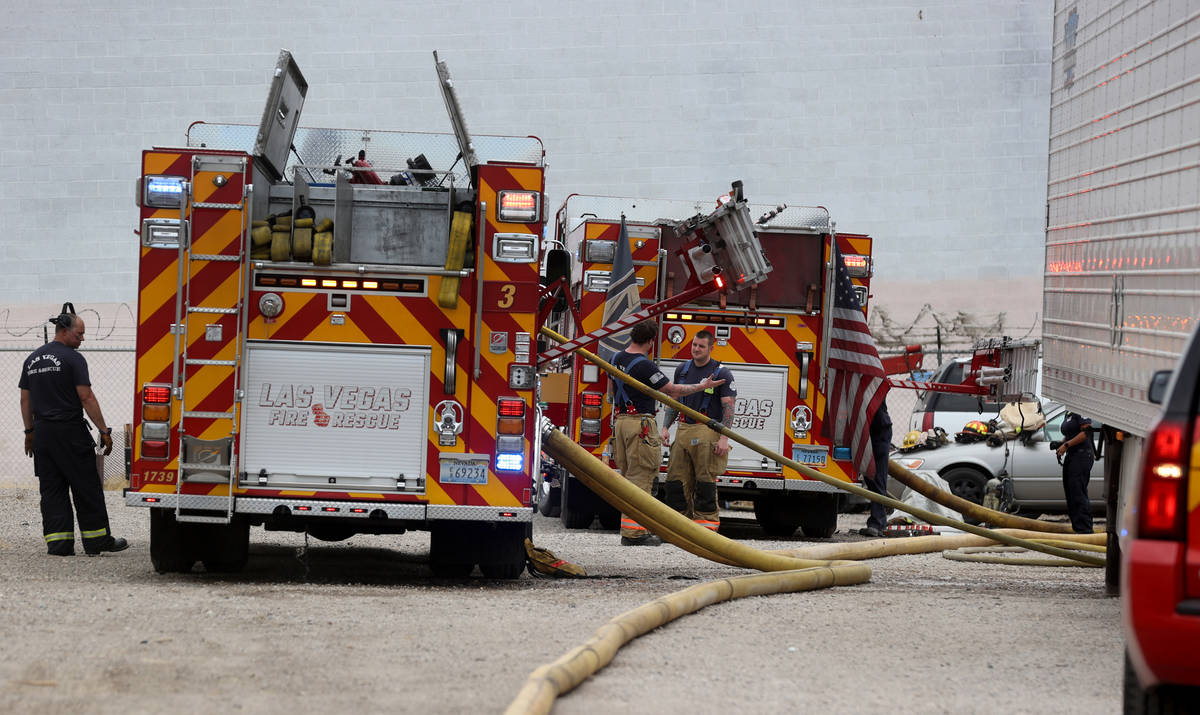 Las Vegas firefighters work a fire off B Street and West Owens Avenue near the railroad tracks ...
