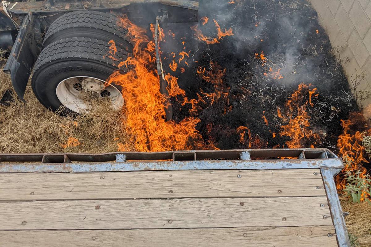 Crews battle a fire Tuesday, June 22, 2021, off West Owens Avenue in Las Vegas. (Las Vegas Fire ...