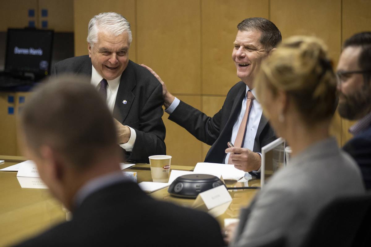 Nevada Gov. Steve Sisolak, left, and U.S. Labor Secretary Marty Walsh, participate during a rou ...