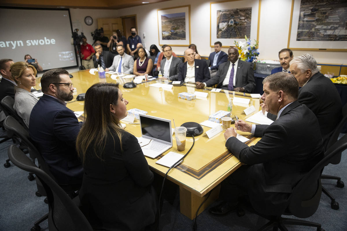 U.S. Labor Secretary Marty Walsh, right, speaks during a round table discussion on the American ...