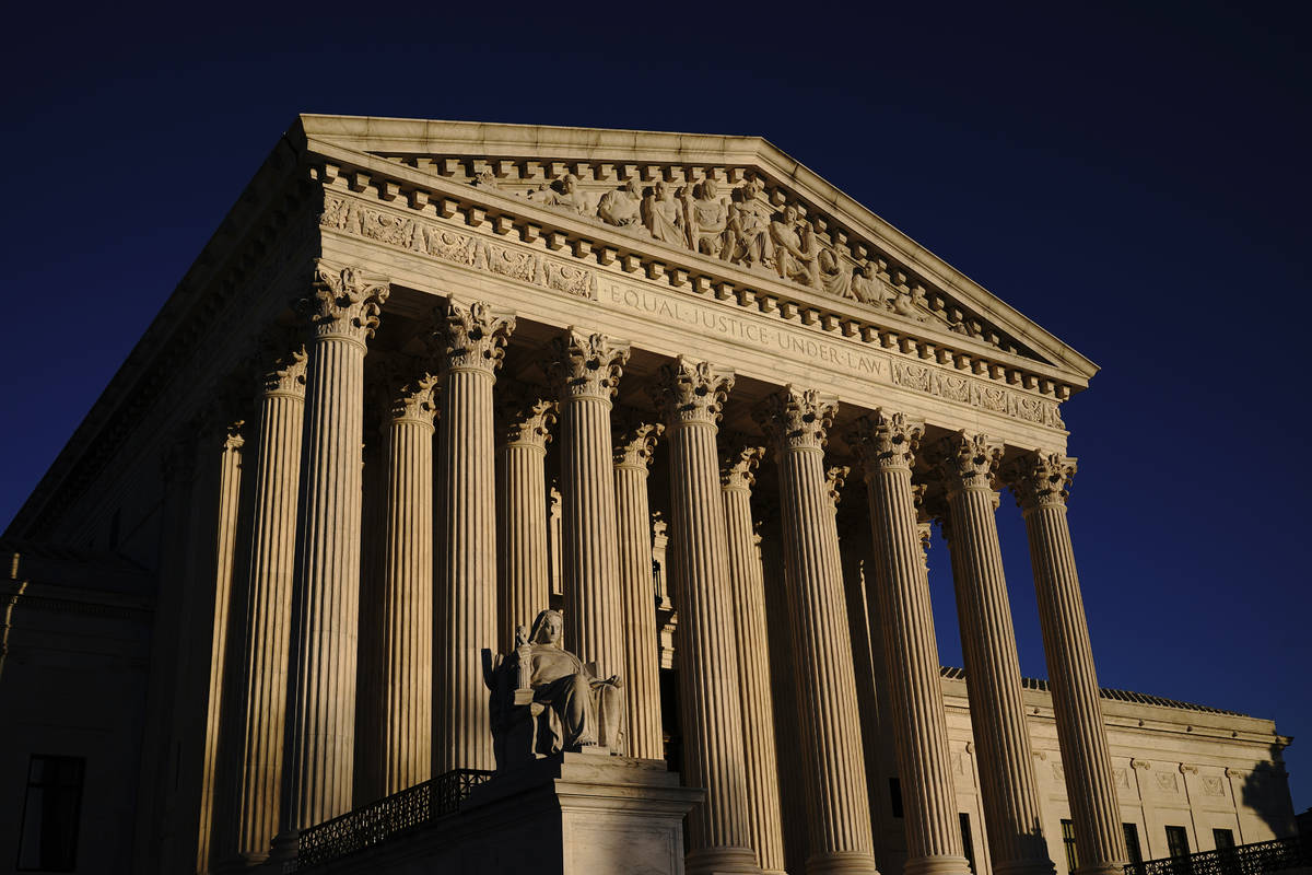 FILE - In this Nov. 2, 2020, file photo the Supreme Court is seen at sundown in Washington. (AP ...