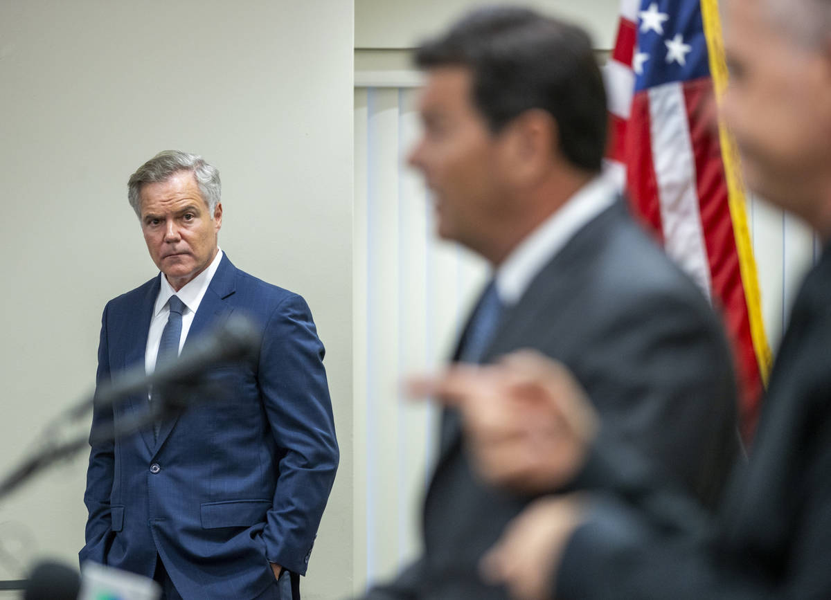 The Nevada COVID-19 Response, Relief and Recovery Task Force Chairman Jim Murren, left, looks o ...