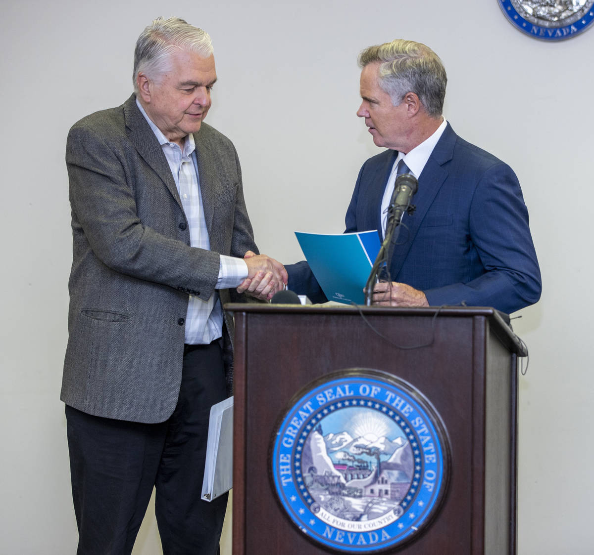 Gov. Steve Sisolak, left, shakes hands with the Nevada COVID-19 Response, Relief and Recovery T ...