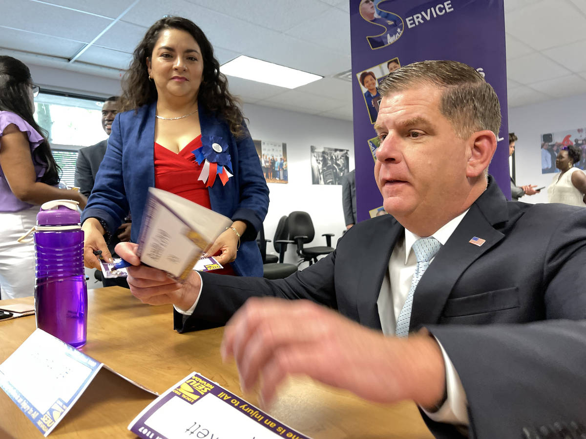 U.S. Secretary of Labor Marty Walsh signs SEIU Local 1107 labor union members name placards, in ...