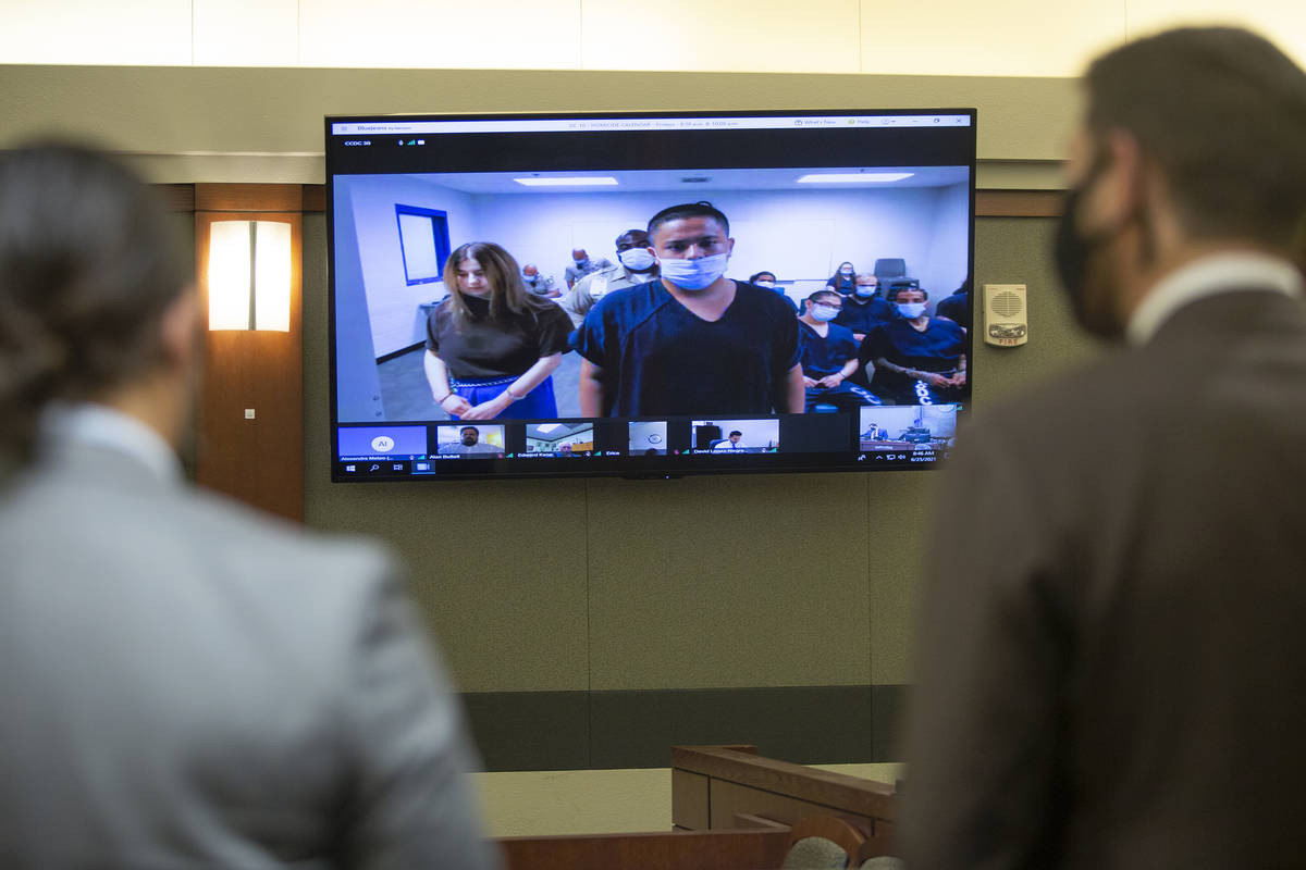 Sierra Halseth and Aaron Guerrero, charged in the slaying of her father, Daniel Halseth, appear ...