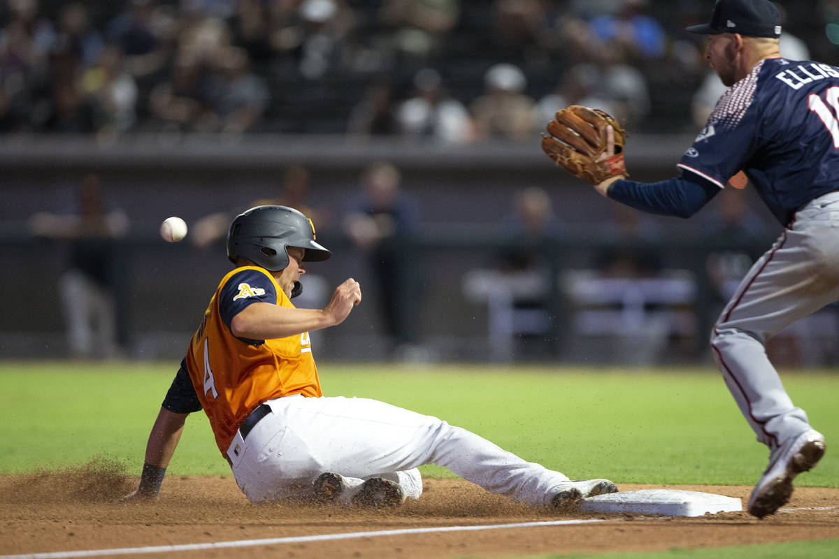 Aviators infielder Jacob Wilson (4) slides safely into third base while Aces third baseman Drew ...