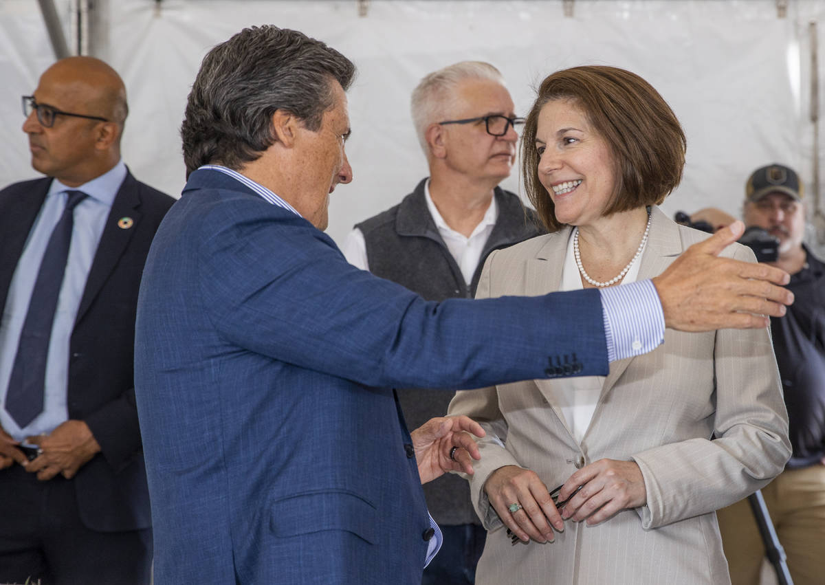 Bill Hornbuckle, CEO and president of MGM Resorts, chats with Sen. Catherine Cortez Masto durin ...