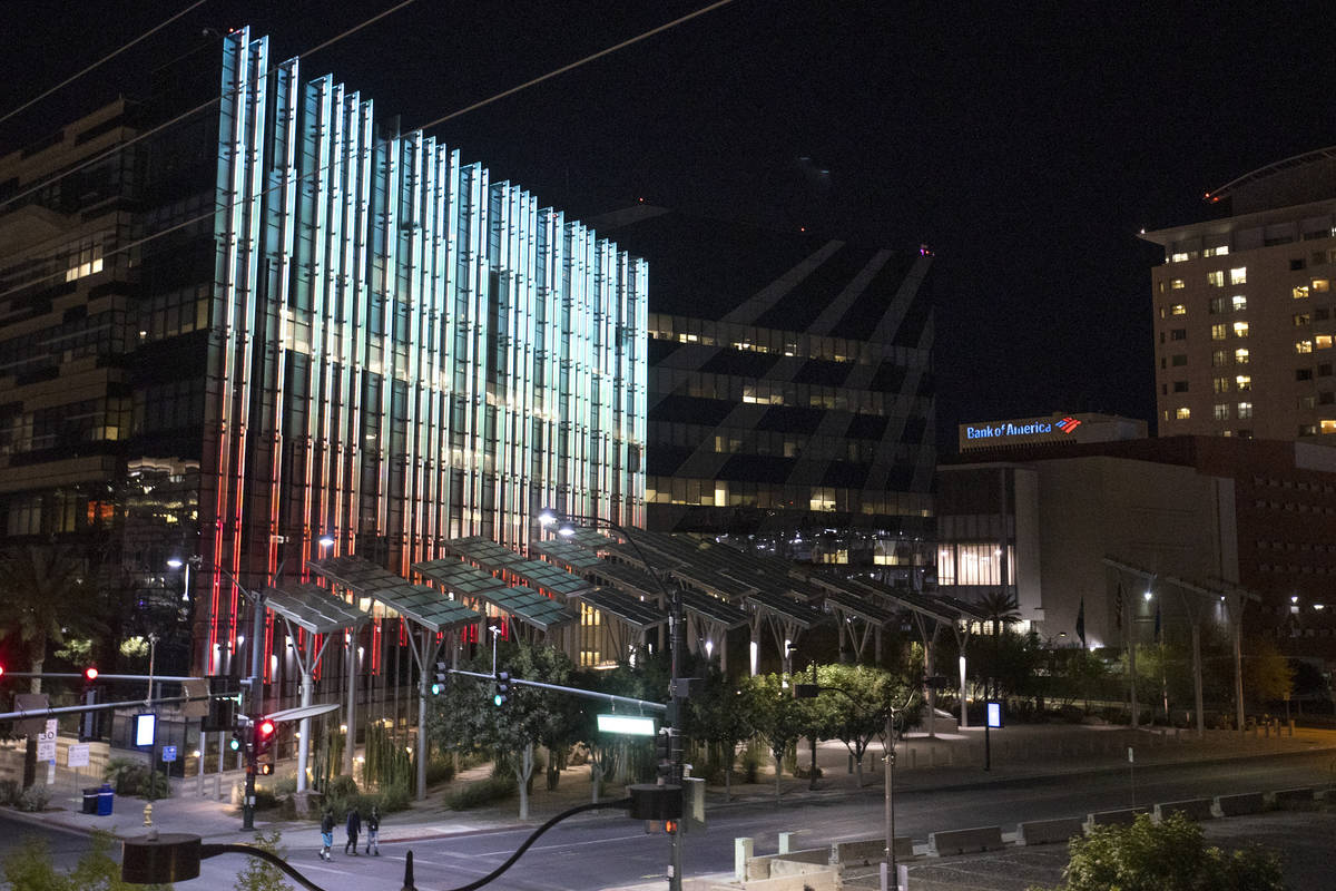 In this June 8, 2020, file photo, Las Vegas City Hall are lit up with crimson and gold. (Ellen ...