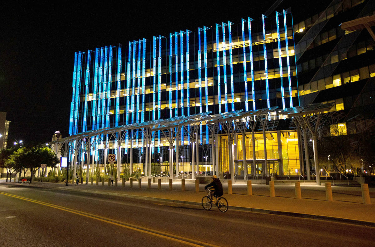 In this April 28, 2020, file photo, Las Vegas City Hall is lit up with blue and white lights. ( ...