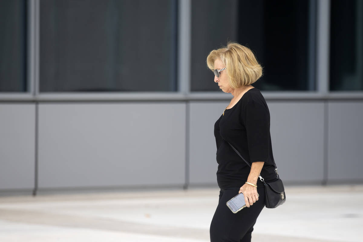 Former 24/7 Vaults employee Sylviane Della Whitmore exits the Lloyd George U.S. Courthouse afte ...