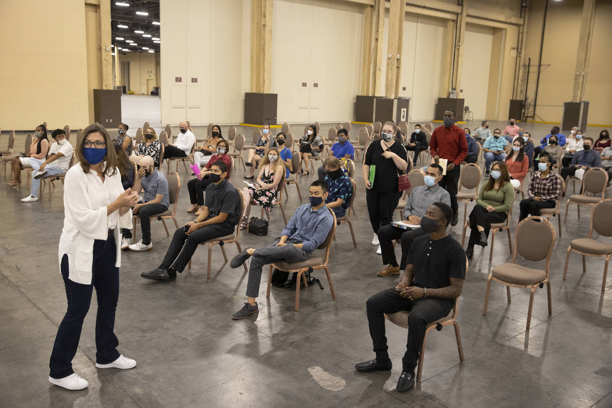 Job seekers wait to be called for an interview during a job fair at the Mandalay Bay Convention ...