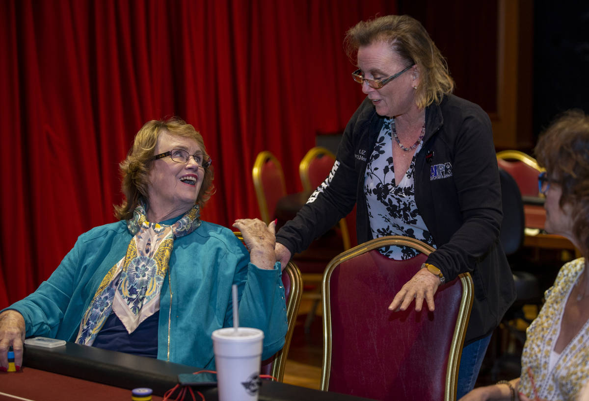 Players Patty Pfeil, left, and Liz Huey talk in between hands as they compete in the $350 buy-i ...