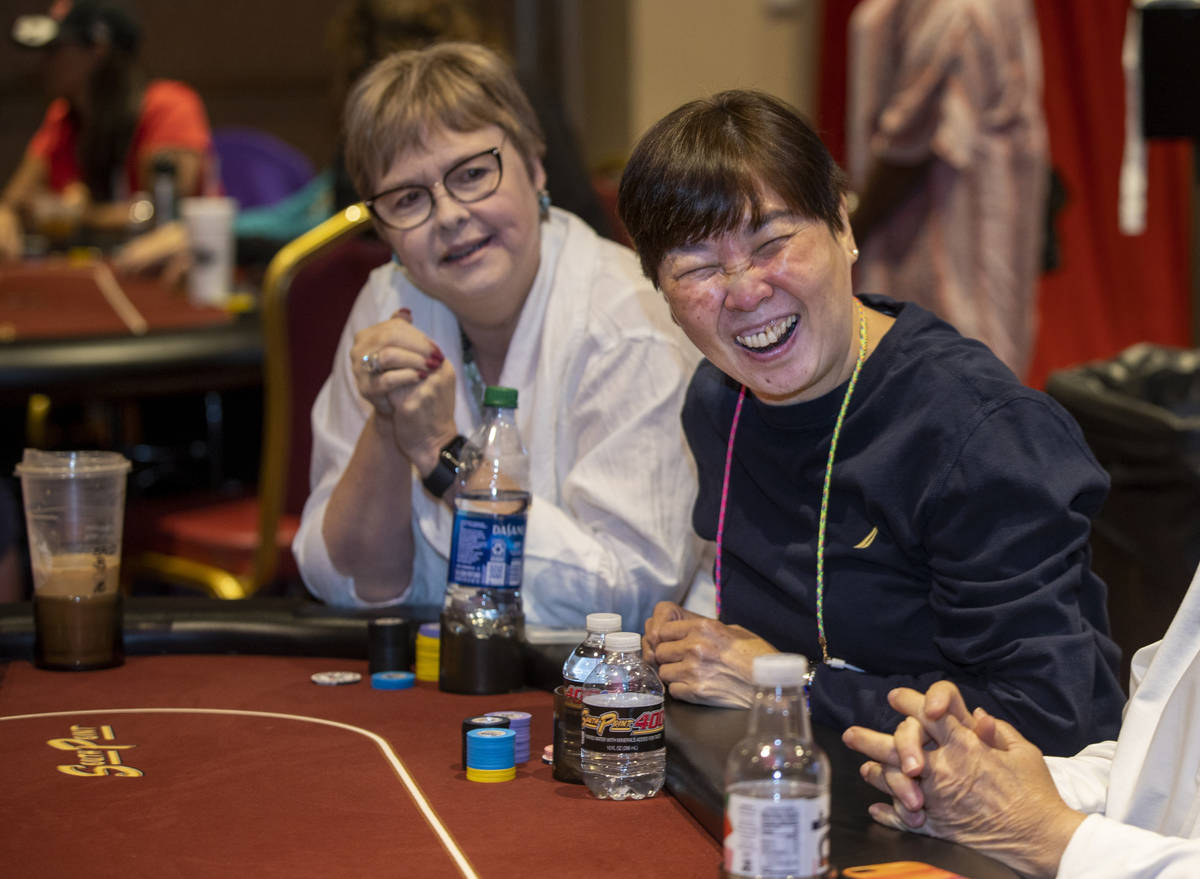 Players Wattana Cruz, right, and Susie Braman share laugh in between hands as they compete in t ...